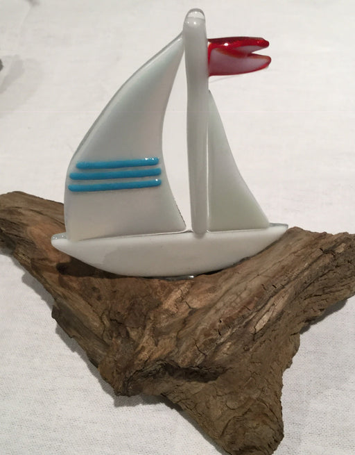 Sail boat mounted on driftwood