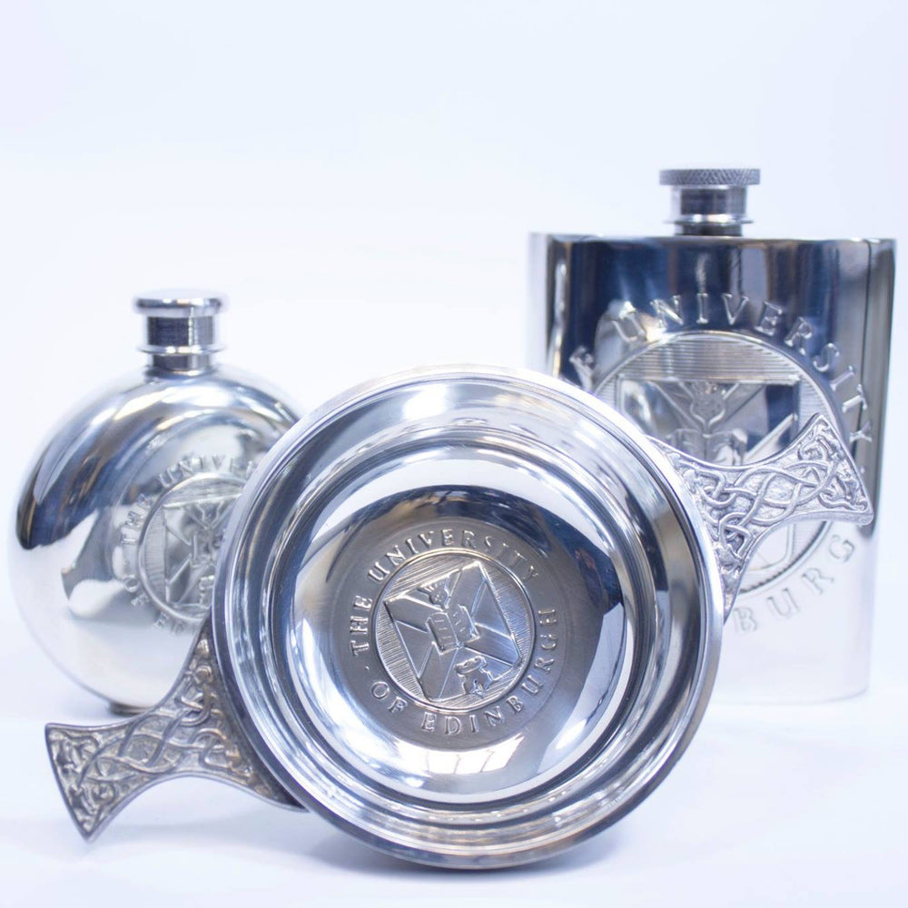 The items in the pewter gift range - round pewter hipflask on the left, quaich in the middle and square hipflask on the right