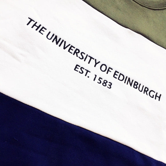 Detail of the embroidery on our Tri-Colour Retro Style Sweatshirt. This reads: 'The University of Edinburgh Est. 1583""