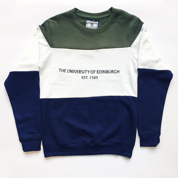 "Our Tri-Colour Retro Style Panel Sweatshirt is a retro inspired, three panel sweatshirt. It has three panels: green, covering the shoulders and top of the chest; white on the middle of chest and elbows; and navy on the bottom of the sweatshirt and end of the sleeves. It also features ""The University of Edinburgh"" embroidery on the middle front part."