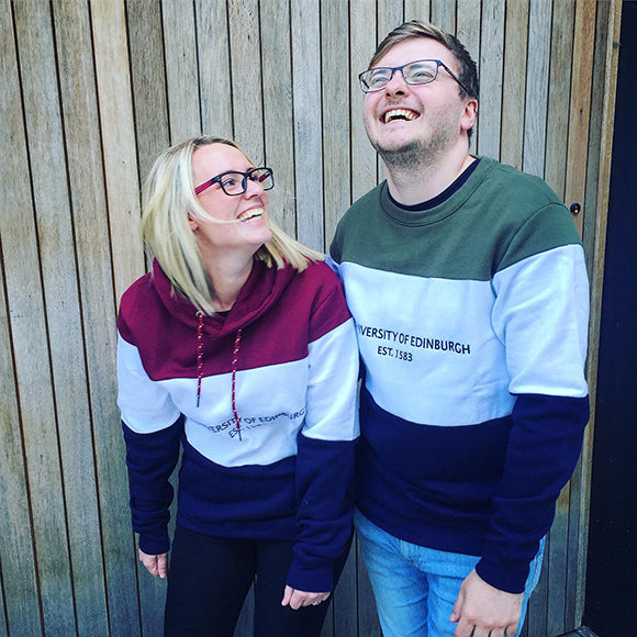 Our models are wearing our Our Tri-Colour Retro Style Panel Sweatshirts. Our female model is is 5ft3 and is wearing a size Small. Our male model  is 5ft11 and is wearing a size Medium