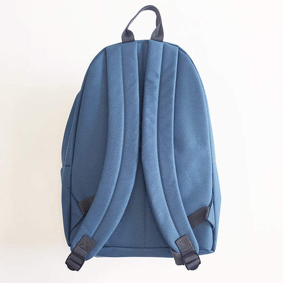 The back of the Heritage Backpack in light blue  displaying padded shoulder straps.