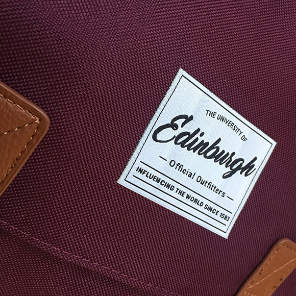 A picture of the back of the Retro -Style Backpack in Burgundy displaying two padded shoulder straps.