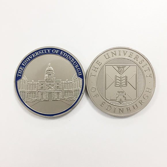 Two nickel coin medals next to each other, one featuring Old College, the other featuring the University crest