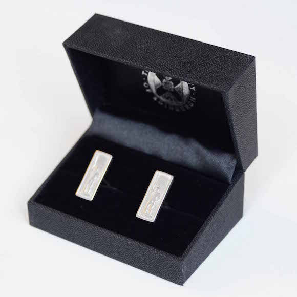Sterling silver rectangular cufflinks with an inlay of the Golden boy.