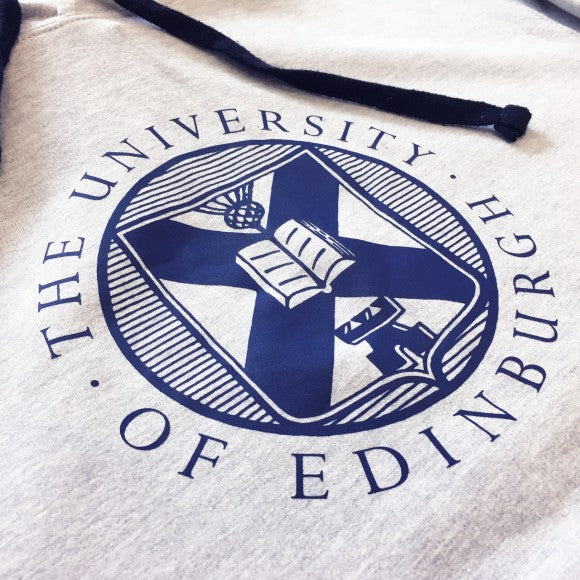 The University logo printed in a bold navy design across the chest.