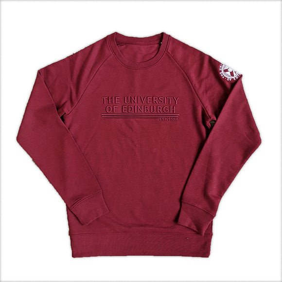 Burgundy sweatshirt with raised embroidery and Universirty crest on the arm
