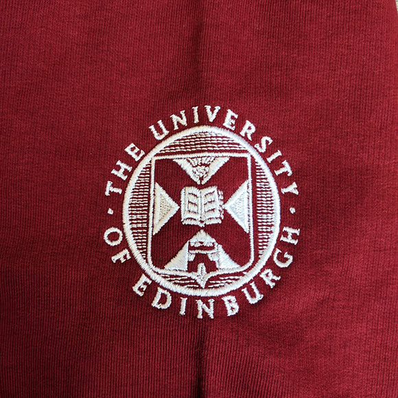Close up image of the sleeve embroidery of the university crest