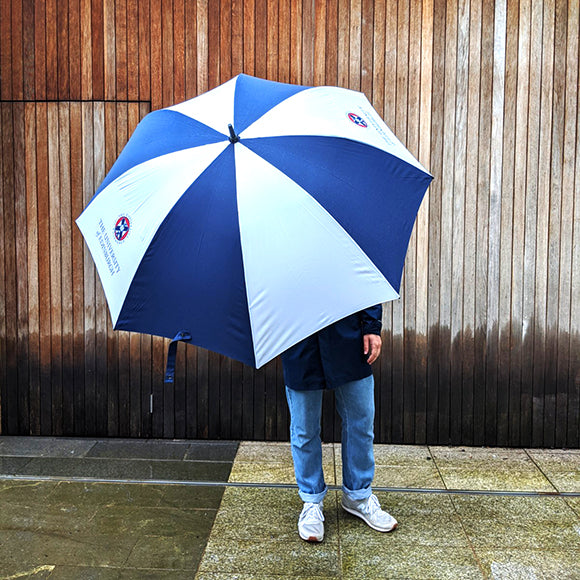 A model holding the large open umbrella. The umbrella is so large  most of the model's body is hidden.