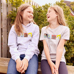Models wearing kids grey hoodie and t-shirt with landmarks design