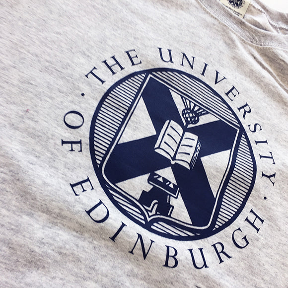Detail of the University of Edinburgh crest, printed in navy on our grey sweatshirt.