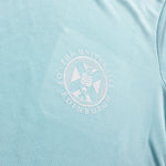 Close up of Ladies Sports T-shirt in Mint. Features white University crest.