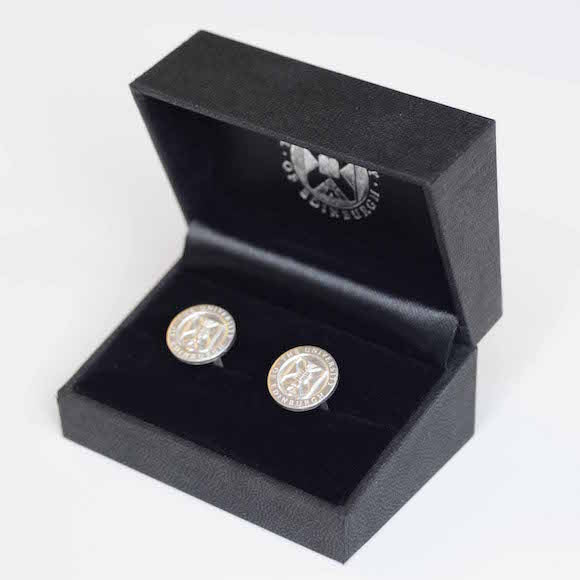 Two cufflinks featuring the Edinburgh University Crest In Silver.