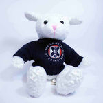Dolly the Sheep stuffed toy in a sweater featuring the University of Edinburgh crest, front view