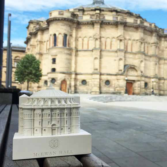 The McEwan hall model positioned outdoors, in front of the Mcwan hall