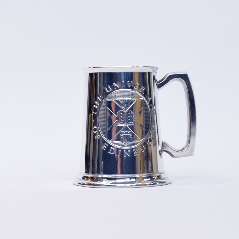 Front view of the pewter tankard, with the University crest visible