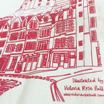 A close up of the illustration of Edinburgh Castle printed in red. Text reads: Illustrated by Victoria Rose Ball, www.victoriaroseball.com