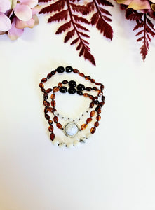 Layered Dark Cognac Bracelets with Marble Spacers.