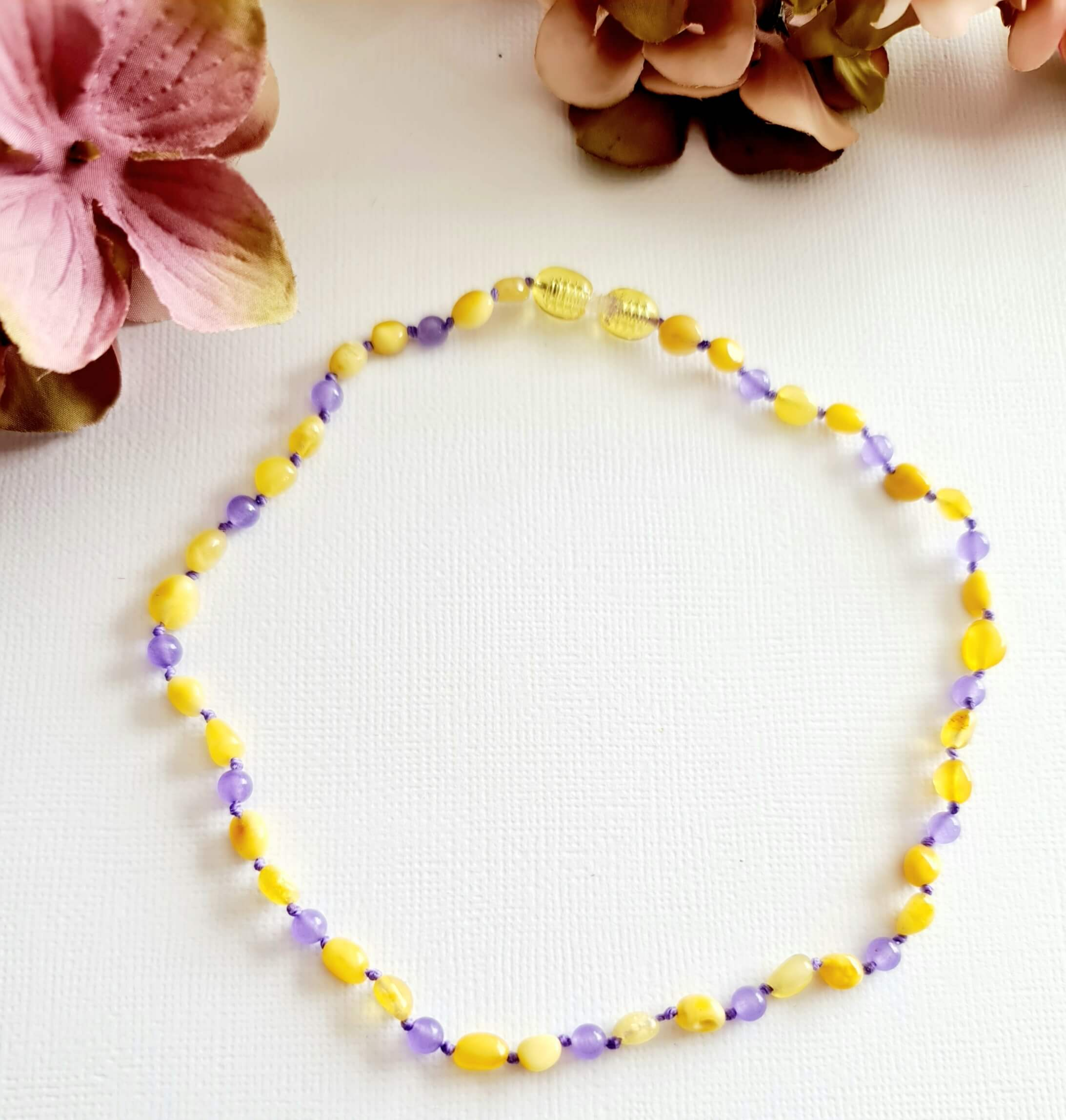 Butterscotch Amber Necklace With Purple Spacer