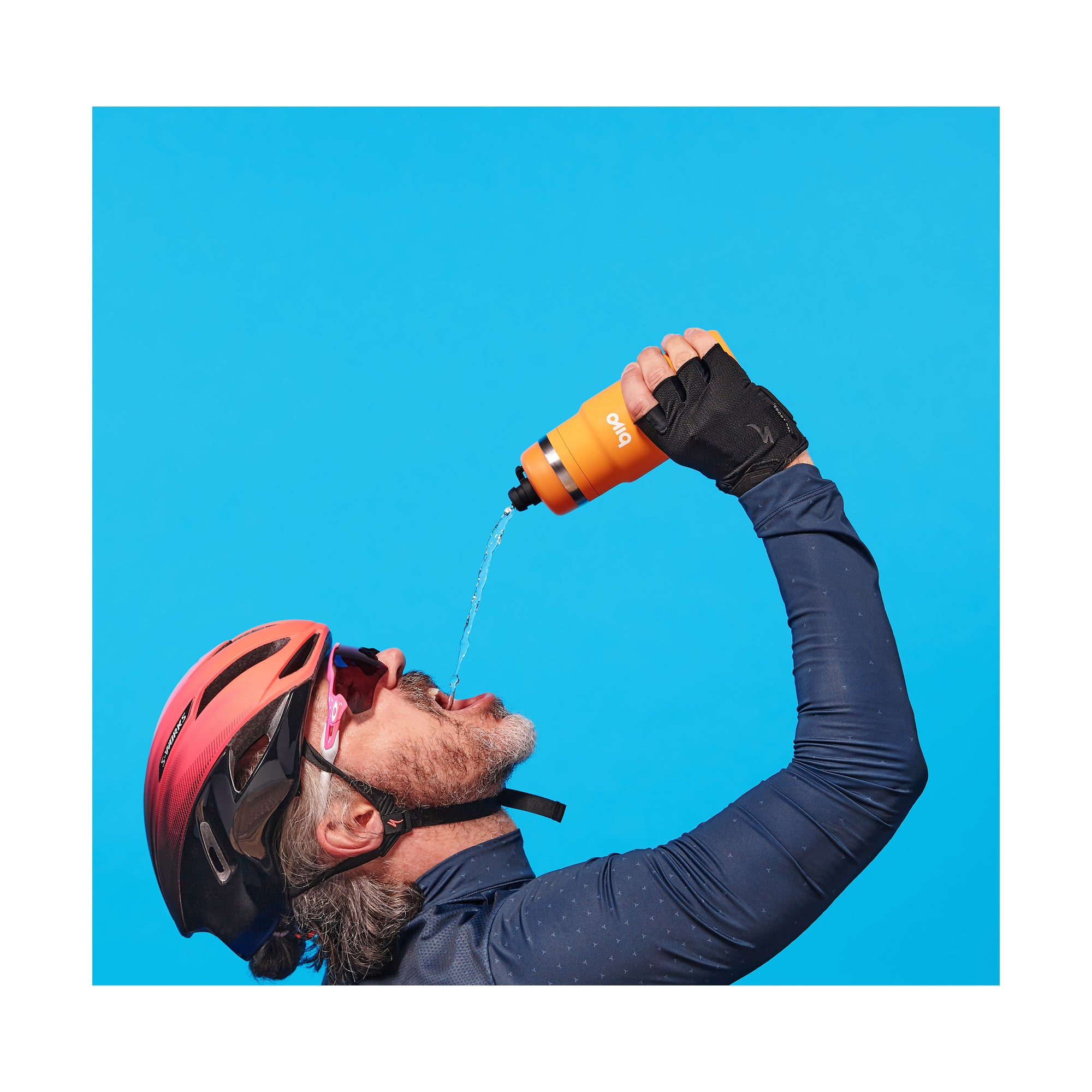 Bike rider drinking from a Bivo One stainless steel cycling bottle with a flow-rate fit for astronauts. Built so you never have to experience the taste of plastic or mold again. Clean taste.
