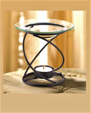 Metal spiral base holds a glass dish for oil. Simple and elegant design that pair great with any decor.