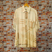 Load image into Gallery viewer, off-pink-patterned-90s-fresh-vintage-shirt-on-hanger