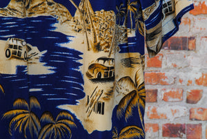 fresh-vintage-miami-beach-shirt-in-dark-blue-with-palmtrees-on-hanger-zoom-car-at-beach-with-palmtrees