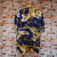 Load image into Gallery viewer, fresh-vintage-miami-beach-shirt-in-dark-blue-with-palmtrees-on-hanger-back