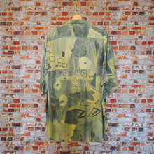 Load image into Gallery viewer, Aesthetic-vintage-shirt-in-khaki-and-beige-from-the-fresh-vintage-collection-on-hanger-back-side