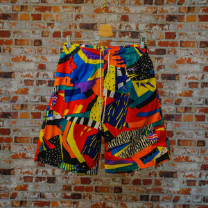Funky-fresh-vintage-shorts-in-multi-colors-on-hanger-with-two-white-cords-for-extra-stretching-or-tightning-front
