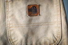 Load image into Gallery viewer, washed-orange-carhartt-jeans-achterzak