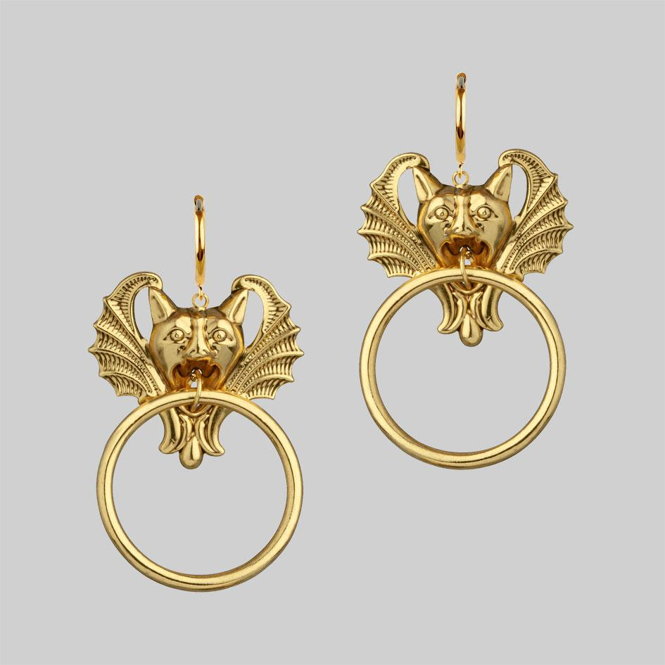 Gold gargoyle earrings