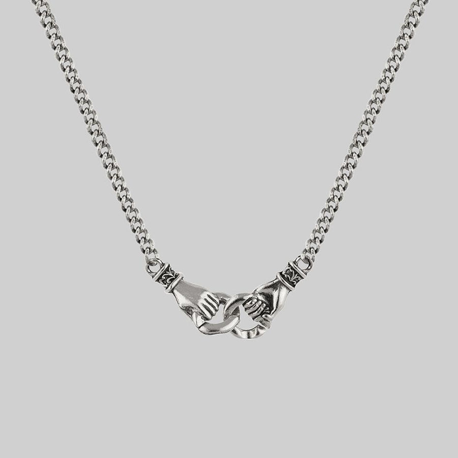 Hands-holding-silver-necklace