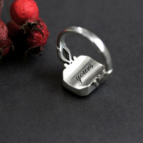 heart under glass ring with message