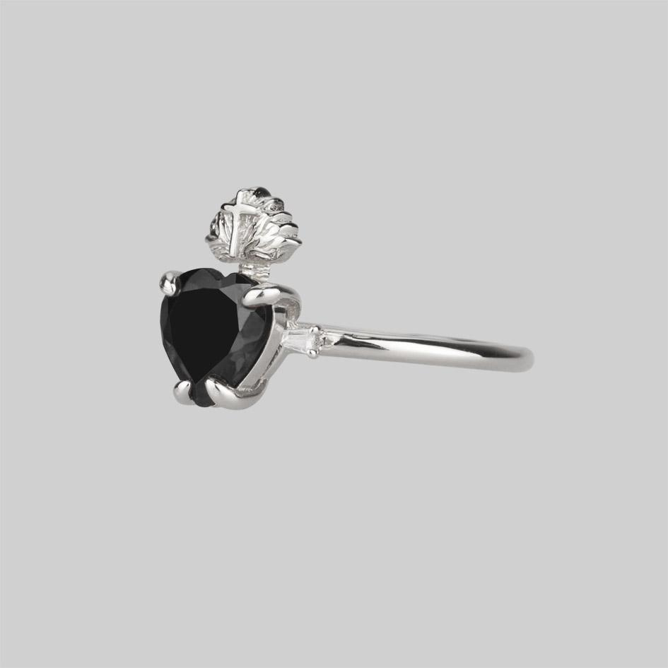 Silver heart ring with black gemstone