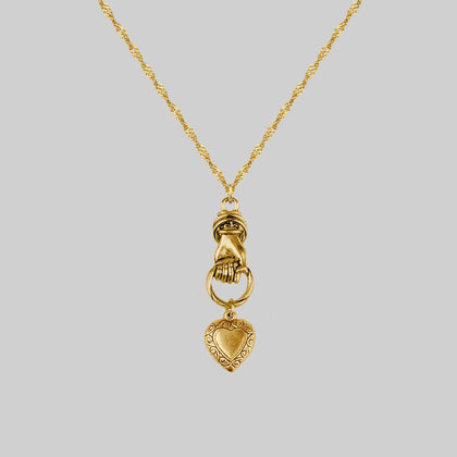 ALL OF ME. Hand Grasping Heart Necklace - Gold
