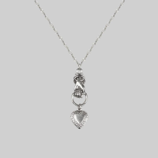 ALL OF ME. Hand Grasping Heart Necklace - Silver