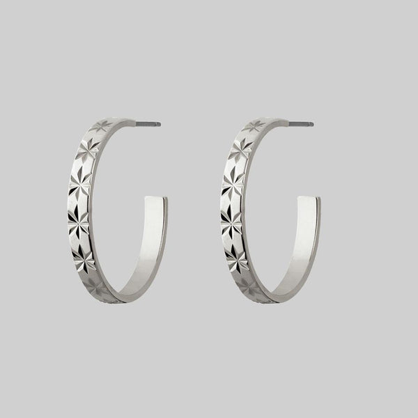detailed star hoop earrings pair
