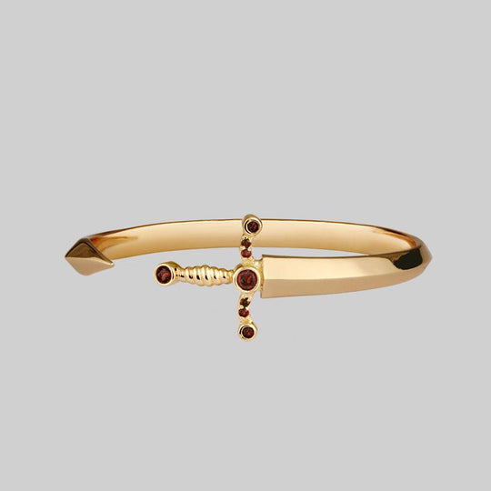 MAJESTY. Garnet Dagger Cuff Bangle - Gold