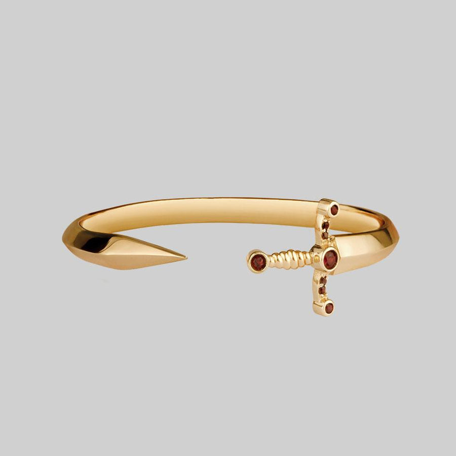 gold dagger bangle with gemstones