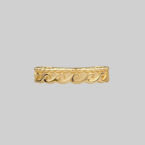 gold ring with wave ocean design