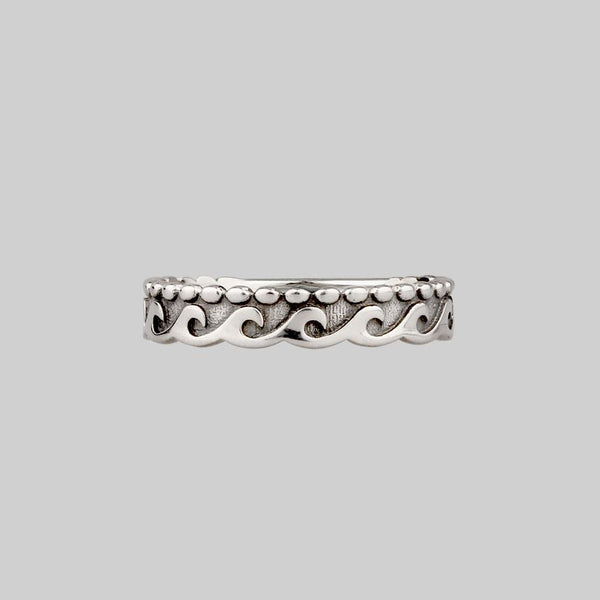 silver  band ring with dotted waves pattern