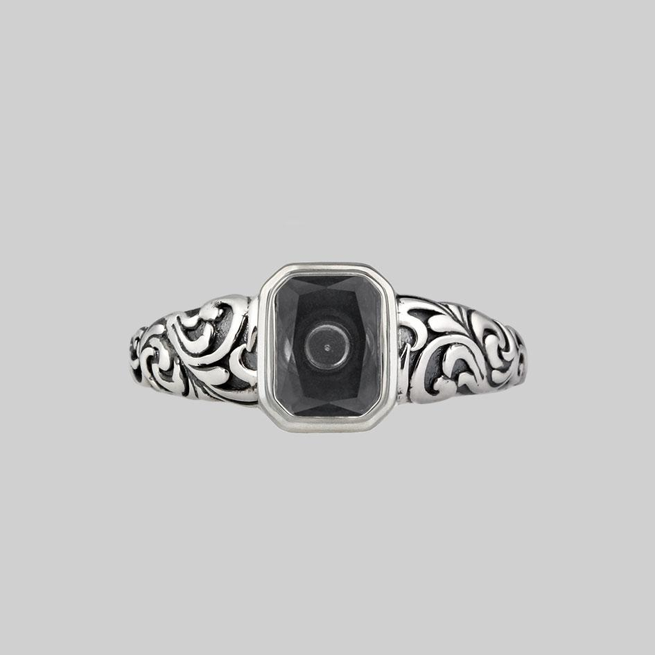 Ornate silver ring with glass cremation ashes chamber