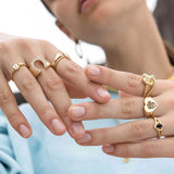 gold rings, sacred heart, model wearing