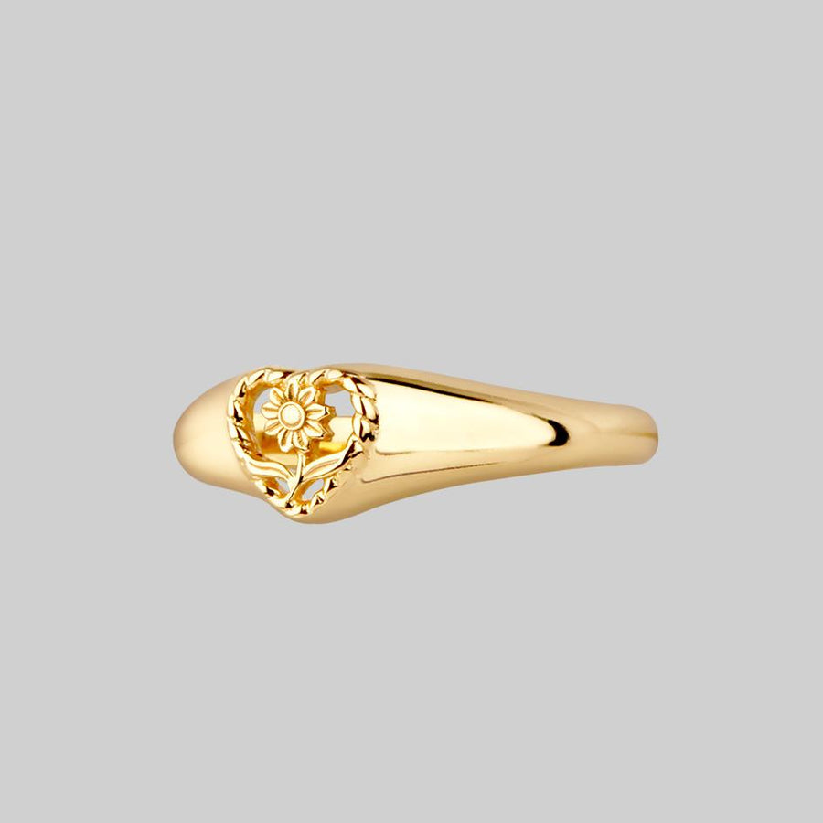 thick gold ring with sunflower