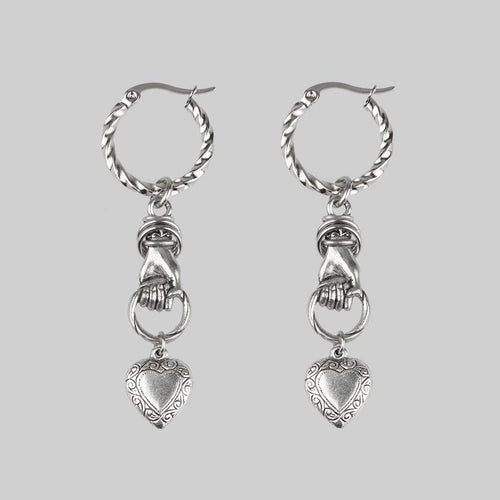 hand grasping heart silver hoop earrings