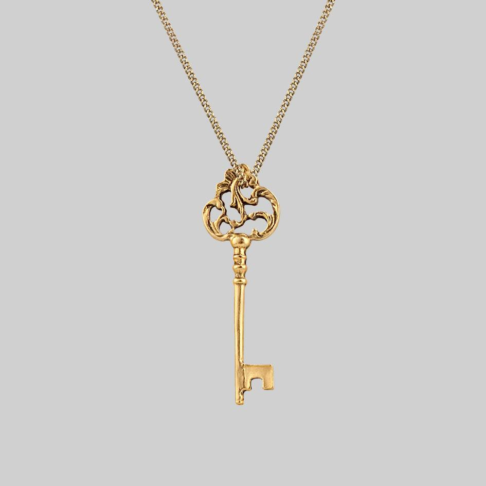 long gold key layering necklace