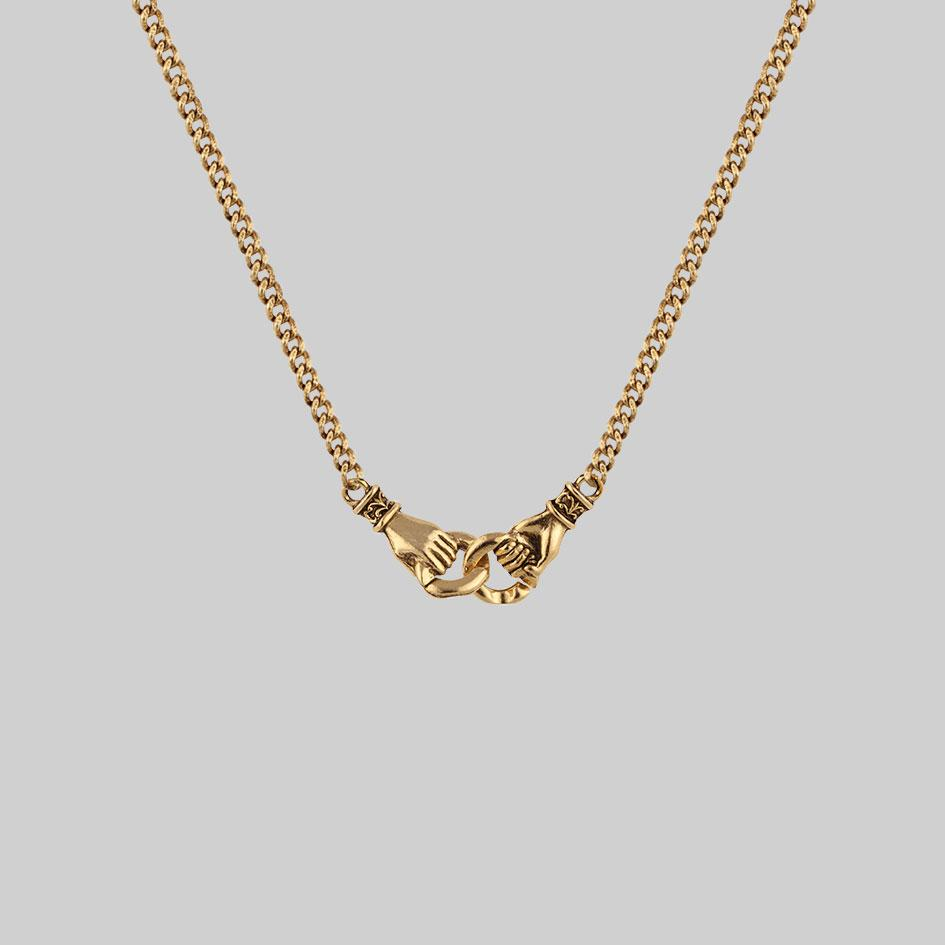 Gold necklace, holding hands necklace