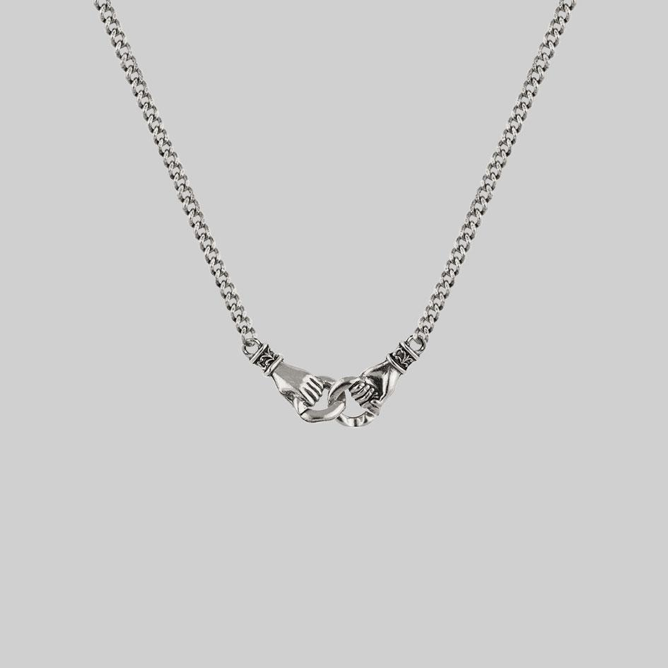 silver necklace, holding hands necklace