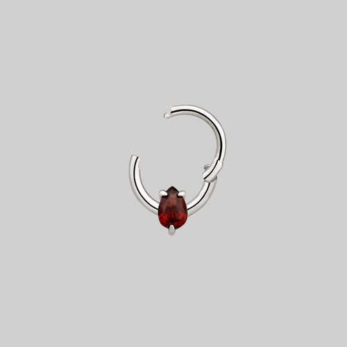red nose ring and daith body jewellery